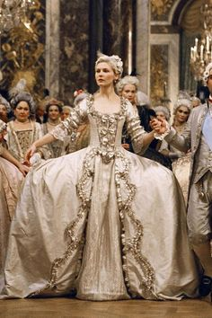 marie antoinette, kirsten dunst in an opulent three-quarter-sleeve gown with bow details and large panniers by milena canonero. Costume Marie Antoinette, Kirsten Dunst Marie Antoinette, Marie Antoinette Film, Movie Wedding Dresses, Wedding Movies, Wedding Gowns, Silver Gown, Iconic Dresses, Vogue