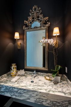 French powder Room features walls painted bold black lined with a silver leaf beaded mirror over a marble floating sink illuminated by antique brass sconces. Powder Room Decor, Powder Room Design, Powder Rooms, European Home Decor, Black Walls, Bathroom Colors, Luxury Interior Design, Beautiful Bathrooms, Beautiful Interiors