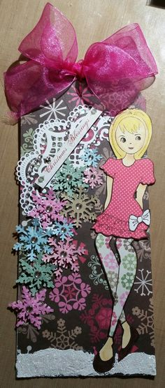 Julie Nutting paper dolls  Dita. Colorful snowflakes