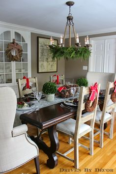 I kind of like this centerpiece for my dining room. Classic dining room, fresh greens on chandelier - Driven by Decor - Our Christmas Home Tour Christmas Chandelier Decor, Chandelier Ideas, Kitchen Chandelier, Diy Pinterest, Design My Kitchen, Christmas Room, Christmas Trees, Christmas Mantles, Christmas Fireplace