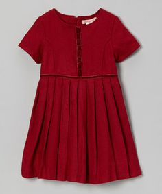 This dainty dress was made to be memorable. A pleated skirt and bold hue beautifully balance its as-sweet-as-can-be velvet trim and short sleeves.