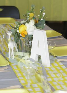 Gray and Yellow! Rinse. Repeat.: baby shower.  (I like the A. with giraffe.  and ribbon running along the middle of the table runner)
