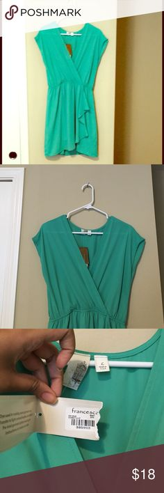 NWT Francesca's V-neck dress in Turquoise Received this as a gift but was large on me so it has never been worn! Adorable dress for going out on its own or paired with stockings for a formal party. V-neck with flirty ruffle details on the waist! Francesca's Collections Dresses