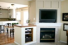"<p style=""text-align: center;""><a href=""http://www.remodelaholic.com/2010/08/existing-fireplace-remodel-guest-remodel/"" target=""_blank"" rel=""nofollow"">Little Bits of Bliss</a></p>"