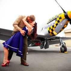 He's a navy pilot. She's a vintage pin up. This is one retro fabulous engagement shoot. (via by David Champagne Photography)
