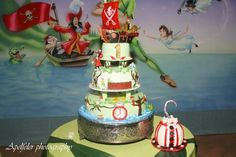 Peter Pan Cake - Would love for each tier to have something special: Pixie Hollow, Mermaid Lagoon, Pirate Ship...