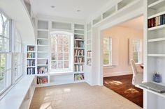 Sunroom + floor-to-ceiling bookshelves?!  *swoon*