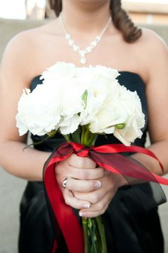 Black dress red and black ribbon on white bouquet