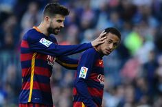 Gerard Pique of FC Barcelona talks to his team mate Neymar of FC Barcelona after being shown a yellow card by the referee Clos Gomez during the La Liga match between FC Barcelona and Villarreal CF at Camp Nou on November 8, 2015 in Barcelona, Catalonia.