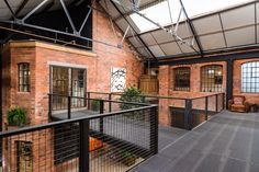 The architects of BPN designed The Compound, a multipurpose creative space which is a place for art, a workshop, a little cinema, a space for filming and a stage for drama productions and a home! Photo by Tom Bird Warehouse Living, Warehouse Home, Warehouse Design, Industrial Bedroom, Industrial House, Industrial Chair, Industrial Shelving, Modern Industrial, Industrial Wallpaper
