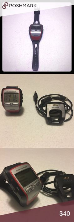 Garmin Forerunner 305 watch Excellent watch! Super simple and easy to use. Does not come with heart rate monitor. Has charging cable that will plug into any USB power source (like an iPhone block). Unisex GARMIN Jewelry