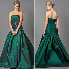 Love the colour and the, uh, back of this deep green wedding gown  -from cinncinati-weddings.org