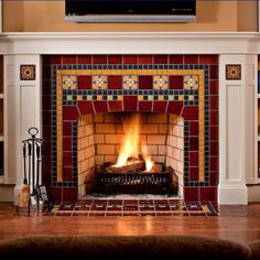 Tile fireplace featuring Frank Thomas House art tile from Motawi Tileworks' Frank Lloyd Wright Foundation collection and warmly colored field tile Craftsman Fireplace, Slate Fireplace, Simple Fireplace, Victorian Fireplace, Farmhouse Fireplace, Fireplace Remodel, Modern Fireplace, Brick Fireplace, Fireplace Surrounds