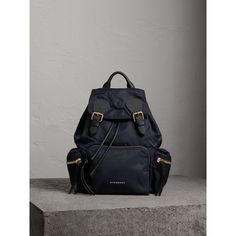 Burberry The Medium Rucksack in Technical Nylon and Leather ($1,495) ❤ liked on Polyvore featuring bags, backpacks, embroidered backpack, military backpacks, leather backpacks, burberry backpack and leather rucksack
