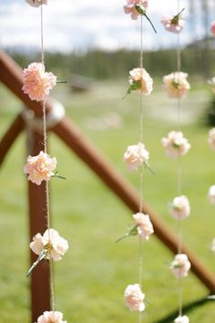 This is a great idea for a backdrop at your wedding. You could choose any flower you want! #westernwedding #countrywedding