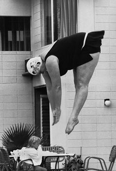 Key West 1971 by Michael Carlebach  I HOPE SHE'S DIVING INTO A POOL.....