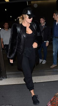 Almost casual: Khloe trotted through LAX in a pair of brother-in-law Kanye West's Yeezys instead of her usual high heels, which she wore with three-quarter black pants with a tank Khloe Kardashian Outfits, Koko Kardashian, Khloe Kardashian Photos, Kardashian Jenner, Kardashian Fashion, Yeezy Fashion, Yeezy Outfit, Fur Jacket, Fitness Fashion
