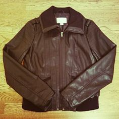 "Faux Leather Moto Jacket EUC, only worn a few times.  Measures approximately 18"" W x 21"" L. Sleeves are approximately 25.5"" L. Outer shell: non-leather material Lining: 100% polyester, fully lined Rib: 100% polyester   Ribbed waist for extra stretch, ribbed hem on pockets, and large ribbed collar. Full zipper. Xhilaration Jackets & Coats"