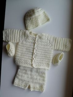 Baby boys blessing day 4 piece outfit in soft satin yarn in a soft cream color. Includes a sweater with pearl buttons, pants, hat and booties. Made with care, it is sure to become an heirloom. The size will fit from 1 to 4 month
