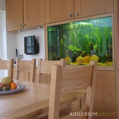 Custom integrated kitchen fish tank from Aquarium Group.