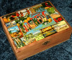 Nice old cigar box, given new life with a beautiful decoupage of real vintage postcard images (no copies!) from the 1930s-1950s! An absolutely