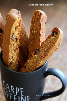 Vegan Gingerbread Biscotti with cranberries, almonds, candied ginger. Easy Crispy Spiced Biscotti Recipe to dunk in a cup of tea. Drizzle with white or dark chocolate. | VeganRicha.com