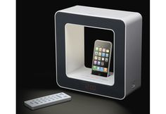 Alarm Clock Lamp Speaker with iPhone Dock... too bad I don't have an iphone... so this is pretty useless to me but it's still cool