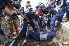 This desperate migrant family were forced off a train by police in Hungary, as authorities...