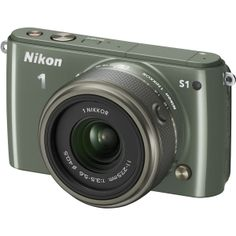 "Nikon 1 S1 10.1 Megapixel Mirrorless Camera with Lens - 11 mm - 27.50 mm (Lens 1), 30 mm - 110 mm (Lens 2) - Khaki - 3"" LCD - 16:9 - 2.5x/3.7x Optical Zoom - Optical (IS) - 3872 x 2592 Image - 1920 x 1080 Video - HDMI - PictBridge - HD Movie Mode"
