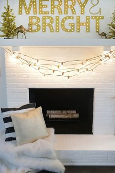 Spray paint light cords gold and hang from the mantle for an easy and festive look this holiday season!