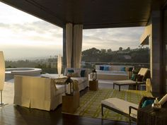 Outdoor patio with cabana curtains and day bed