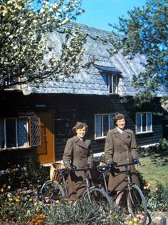 Cruising around: Two female officers of the Women's Army Corps are about to ride their bicycles from the WAC headquarters. Their outfits are complete with olive trench coats and leather riding gloves.
