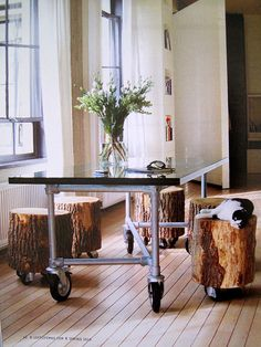 Stumps on casters.... too perfect. I think I'd like this more as an end table or something.