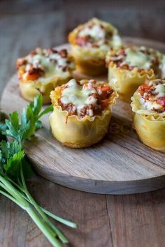 Turn a classic Italian main course into a fun appetizer with these Lasagne Cups! For rustic presentation, check out P.O.S.H. Chicago's wooden cheese boards. http://poshchicago.com/
