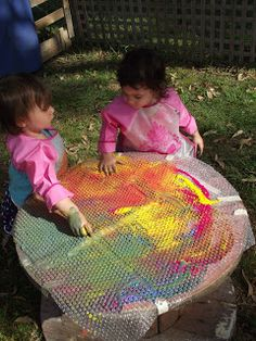 bubble wrap paitning.....just stick some bubble wrap to the table and pour paint on...some children will need encouragement to run their fingers over the bubble wrap as it is a new experience.