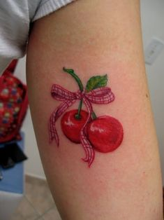Sweet cherry tattoo.  The gingham ribbon is adorable.