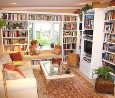 home library/TV room: love the rug, bookshelves & window seat, not crazy about that coffee table or all the beige