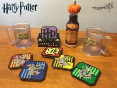 Harry Potter Coasters by RockerDragonfly on DeviantArt Harry Potter coasters perler beads by RockerDragonfly Pixel Art Harry Potter, Harry Potter Perler Beads, Theme Harry Potter, Harry Potter Diy, Melty Bead Patterns, Pearler Bead Patterns, Perler Patterns, Beading Patterns, Hama Beads Coasters