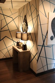 I wonder about doing something like this to our hallway.  I like how this studio is a great mix of eras, but with a distinct art deco overtone.  via Apartment Therapy: Kevin's Cool, Collected Studio