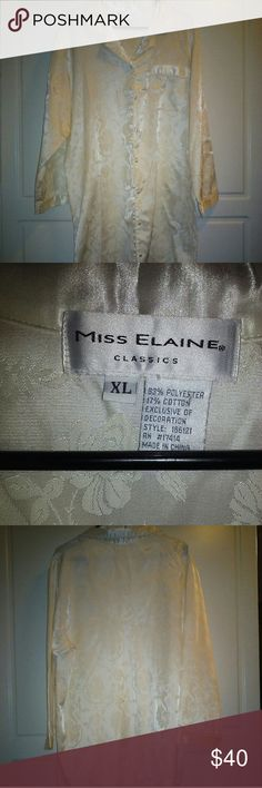 "🌻Miss Elaine Classic XL Woman's Lounge Wear🌻🌻 This Is Absolutely Beautiful! Would Make A Great Gift! Miss Elaine Classic Lounge Wear In Ivory. The Delicate Pattern Is Woven In. 20"" Across Shoulders laying Flat.A Lace Accent Around The Collar! Front Left Pocket. 83% Polyester & 17% Cotton. Fabric Covered Buttons From Neckline To Hem. Cuffs Laying Flat Are 7"". Top Button To Hem Is 32"". Top Of Back Collar To Hem Is 41"". A Feminine Rounded Bottom. No Flaws. Absolutely Stunning!! Any Woman…"