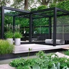 A modernized black pergola works well with the greenery. The light floors of the pergola create a a different level of living space within the garden. Modern Garden Design, Contemporary Garden, Landscape Design, Landscape Plans, Landscape Architecture, Outdoor Rooms, Outdoor Gardens, Outdoor Living, Modern Gardens