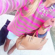 pink striped sweater.