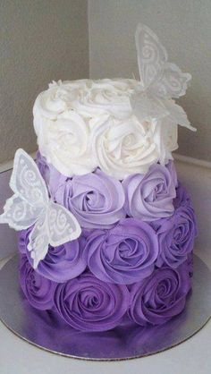 Beautiful cake! cute for a little girl's party...but in PINK....minus butterflies... maybe some pearls!!