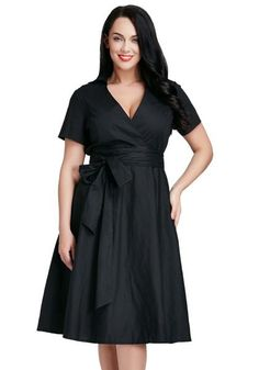 What's New // This incredibly gorgeous plus size surplice midi dress is a superb alternative to your usual LBD.
