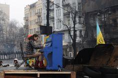 A girl plays the piano on the barricades on Grushevkogo  Street, Kiev, Ukraine, Feb. 10, 2014.