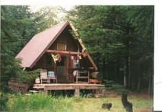 a-frame cabin in the woods (with prayer flags!)