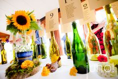 Love the wine bottles for table #/seating chart.