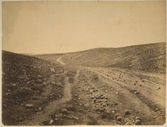 """Shadow of the Valley of Death"" Dirt road in ravine scattered with cannonballs, Crimea. Cannon shot falling short of their target during the Siege of Sevastopol 1855"