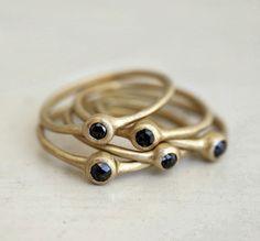 Nestled set of Black rose cut diamond rings.