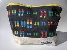 Show off your love for genetics with this cute pouch. What beautiful chromosomes :) A small zipped pouch perfect for holding pencils, makeup, or other small items. This has a sturdy canvas base, with boxed corners so it can stand up.  Size 7 wide (top) / 5 1/2 wide (bottom) x 5 1/2 high x 2 1/2 deep    Materials:  Outer fabric: 100% cotton printed by Spoonflower using eco-friendly methods here in the U.S. Lining fabric: 100% black cotton 100% cotton canvas base Bright yell...